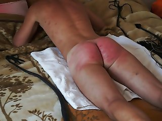 spanking male ass