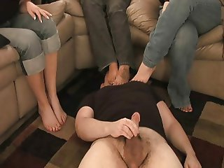 3 babes make dude smell feet and jerk off