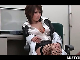 Stunning jap office nymph rubbing huge tits and pussy at work