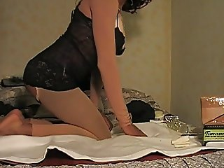 Crossdresser play with feet and ass