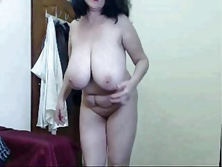 Mature showxing her huge tits while dancing