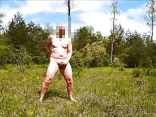 Totaly naked public wank on huge meadow