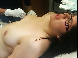 girl getting nipples pierced