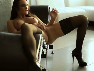 Tanned toned Teal Conrad fondles her big breasts and