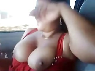 sexy indian babe inside a car