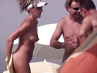 Very horny milf rubbing boobs in nude beach