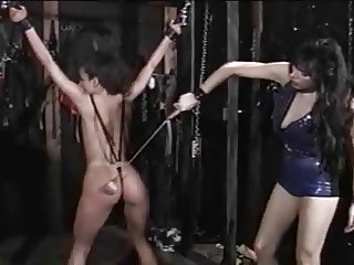 Mistress spanks tied girl