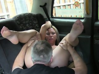 Busty amateur customer foot fucked in the ass by the driver