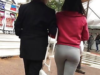 bubble butt in grey yoga pants walking the street