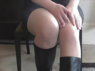 Beautiful legs and feet in pantyhose and boots