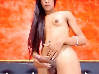 Colombian shemale with small tits, huge cock & balls jerking