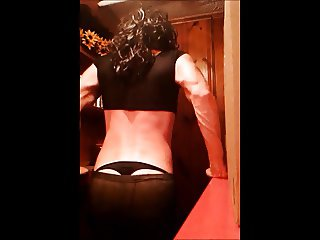 Crossdresser dancing in leggings and thong