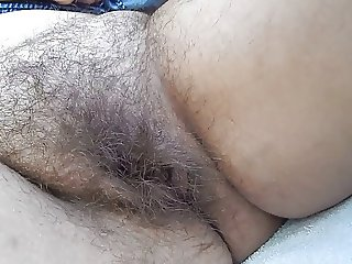 Hairy mature in the car