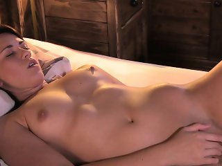 Beautiful brunette babe masturbates in bedroom