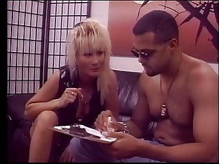Hardcore chick in leather gets her pussy eaten while she smokes a cigarette
