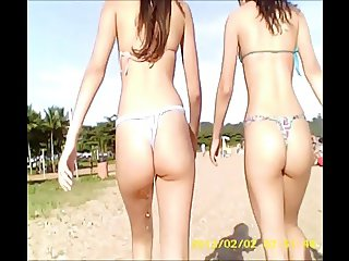 Two skinny young girls in thong bikini on the beach !