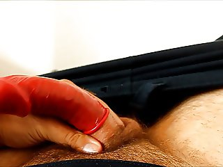 J-Art male solo cock stroking with a condom on