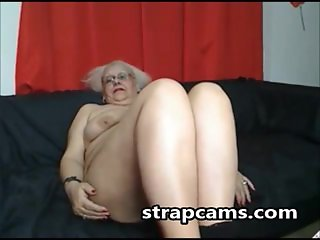 Granny whith glasses show us her body on scre