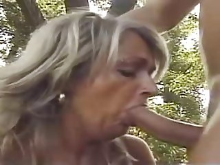 hot mature gets fucked outside by younger guy