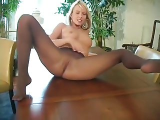sexy blonde babe in black pantyhose