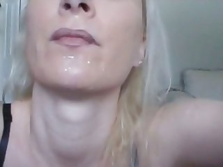 Cigarette in her mouth and cum on her face