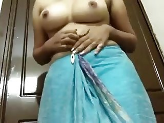 Naughty Indian chick shows off her nicely shaped breasts