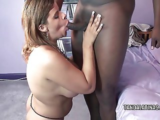 Curvy swinger Angel Lynn swallows a big black cock