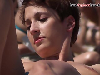 Huge hot boobs Topless on the Beach