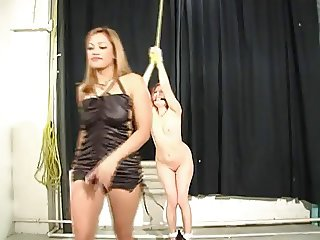 Dominatrix butt spanking slave
