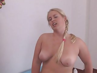 Chubby blond beauty riding