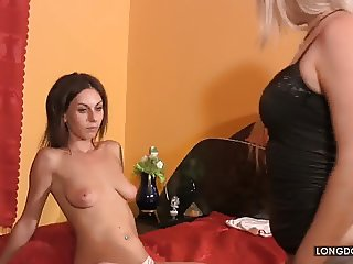 Mistress Cassandra punishes sexy Carmen's tits.