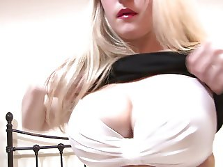 Sensual blonde Brook lies in bed topless in her high boots