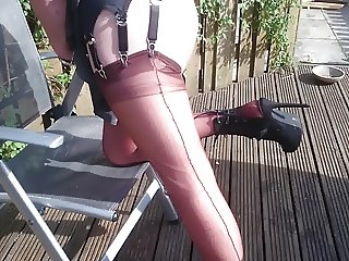 Latex & layered in nylons and pantyhose in the garden