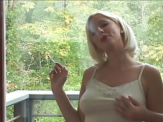 Smoking blonde gets felt up