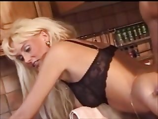 Busty blonde Barbie gets shaved pussy fucked in kitchen