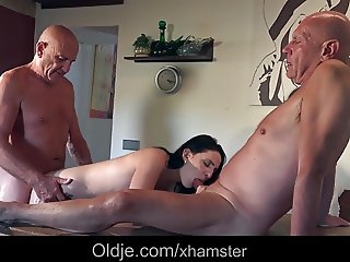 Young babe flirting and fucking two old guys in the kitchen