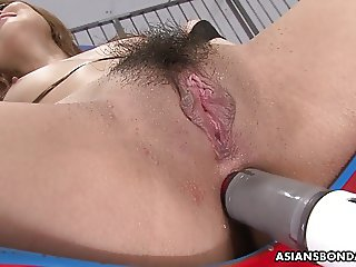 Her muff and her ass take a toy stimulation to it