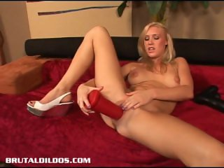 Busty blonde Allison Pierce filling her pussy with a massive dildo