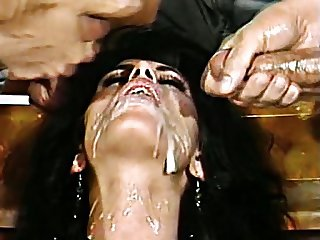 Heather taking a messy simultaneous double facial