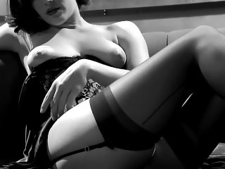 Cutie Bobbi Starr masturbating on the couch in a corset and thigh highs