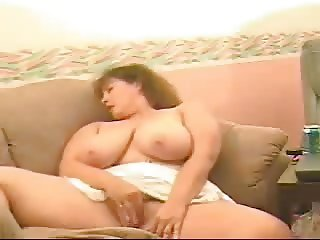 Busty BBW webcam mature lady masturbating on the couch