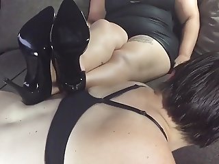 Dyke Lesbian Slave ordered to suck cock by her mistress.