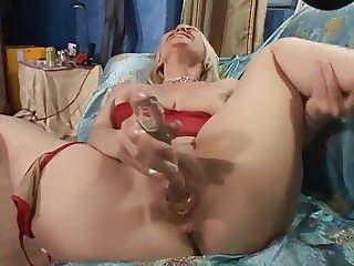 Horny bitch moans while fucking herself with a toy