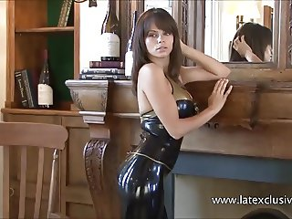 Brunette latex babe Jerrys high heels fetish and tight rubbe