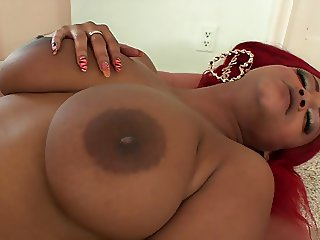 Redhead ebony sits on sexy blonde's face with her pussy