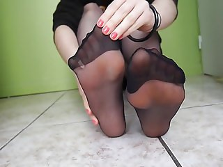 Orange toes in pantyhose