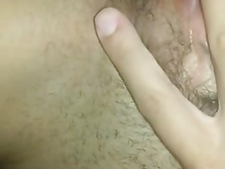 Sexy Girl Rubs Her Clit On Her Hairy Pussy