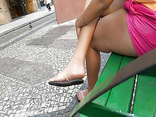 Street Girl barefoot feet in flip flops dirty soles