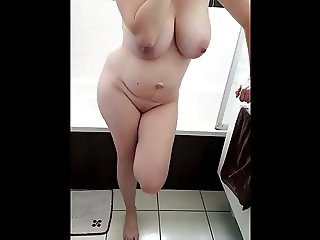 voyeur big tits at phone in bathroom