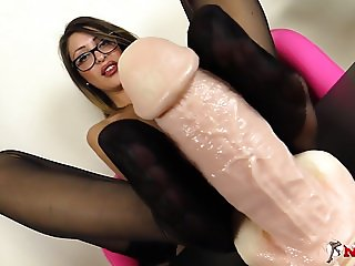 Footjob in nylons by an italian brunette in glasses